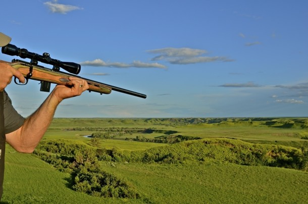 bigstock-Hunter-with-rifle-takes-aim-72105442